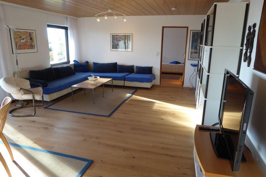 Wohnzimmer mit ausziehbarer Eckcouch