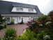 Ferienhaus mit Seeblick, Ferienwohnung Gartenseite