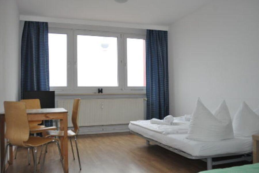 Studio mit Schlafsofa und Einzelbett