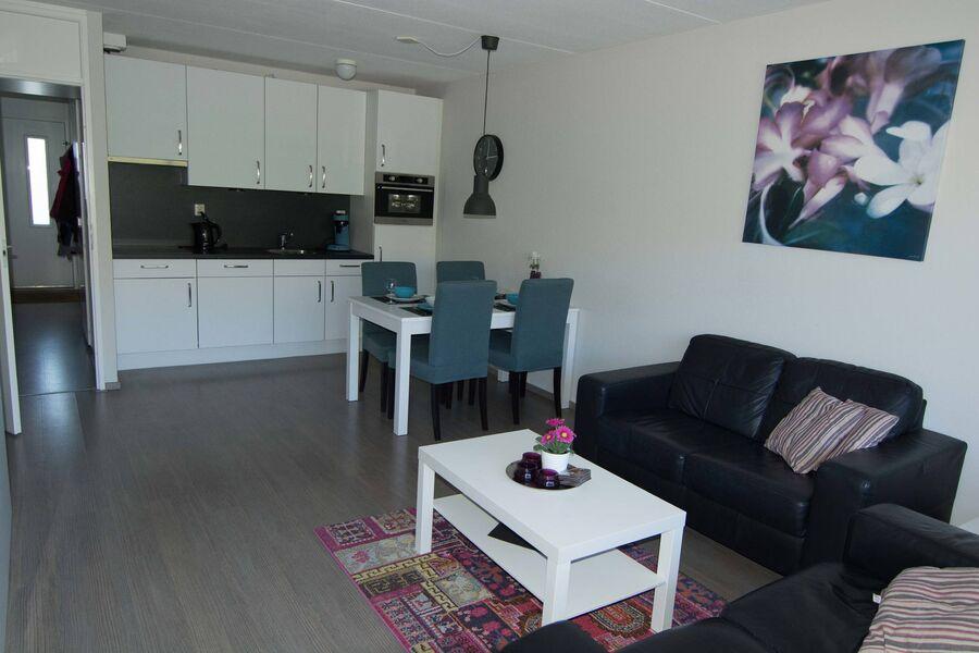 Wohnzimmer mit neue Küche
