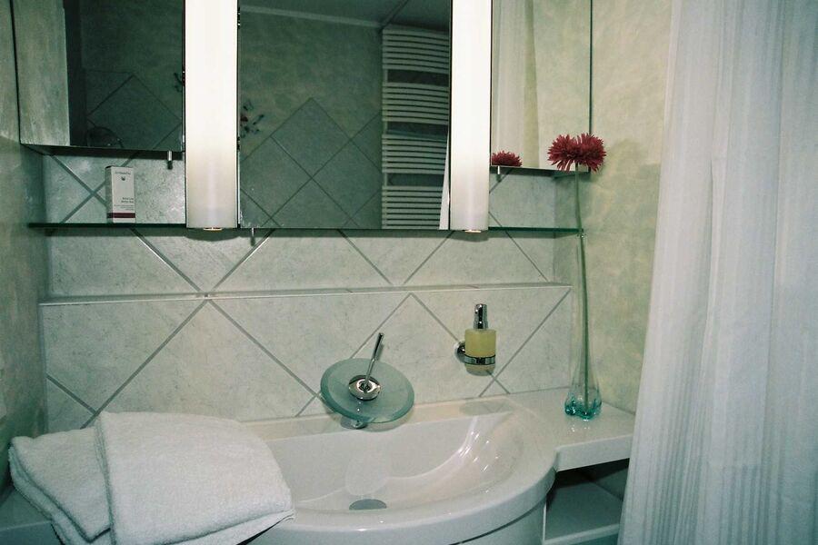 im Badezimmer mit Fußbodenheizung
