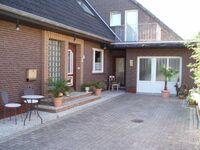 Haus Up't Land - Ferienwohnung Ehnts, Ferienwohnung mit Strandkorb in Carolinensiel-Harlesiel - kleines Detailbild